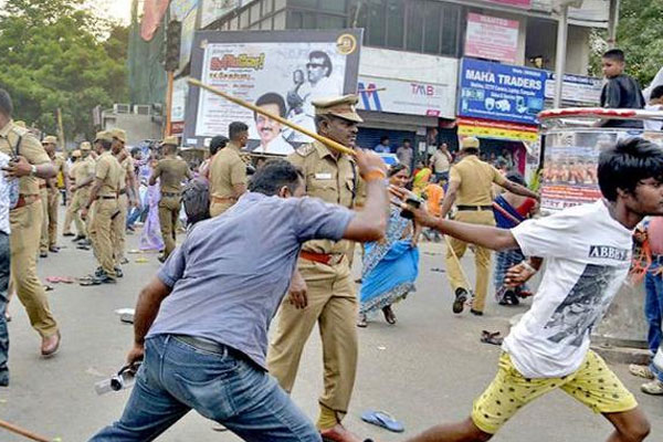 Two boys hit by police van die, people stage protest