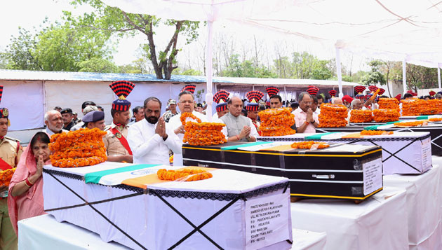 Rajnath Singh pays tribute to the martyred CRPF personnel